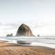 Large Rock rising out of the sea at Cannon Beach, Oregon