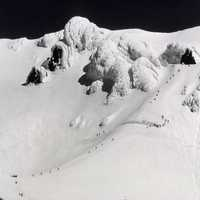 Snow capped peak with climbers on Mount Hood