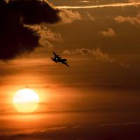 Aircraft flying over the sun during sunset over Charleston, South Carolina
