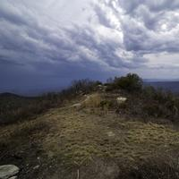 Mound at the Hilltop under lingering storm clouds at Sassafras Mountain, South Carolina