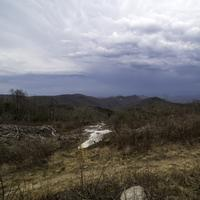 Mountains in the distance in the landscape under rain clouds at Sassafras Mountain