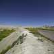 Road through the badlands to the horizon