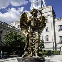 Statue in front of buildings in downtown Nashville