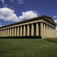 View of the Parthenon of Nashville under blue skies and clouds