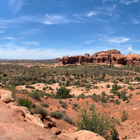Desert landscape sky, shrubs at Arches National Park