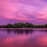 Purple skies and landscape over the lake