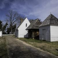 Small buildings supporting a house in Yorktown, Virginia