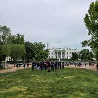 Distant View of the White House with People standing in Front of it