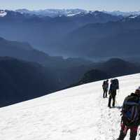 Hiking and climbing in the snow landscape on Mount Baker