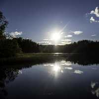 Bright Sun over Day lake in Chequamegon National Forest, Wisconsin