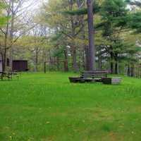 Bench with grassy field at Council Grounds State Park, Wisconsin