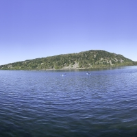 Scenic Panoramic of devils lake with people canoeing