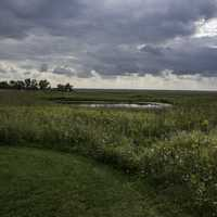 Pond and Field under heavy clouds at Horicon Marsh
