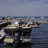 Boats and people sitting on the pier in Madison, Wisconsin