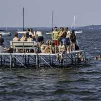 People standing on the pier at swimming in Lake Mendota, Wisconsin