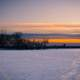 Dusk over the frozen lake landscape on Lake Mendota, Madison, Wisconsin