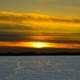Large sunset over snowy Mendota in Madison, Wisconsin