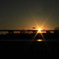 Sun behind highway bridge in Milwaukee, Wisconsin