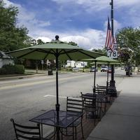 Outside dining place on the sidewalk with sky in Mount Horeb