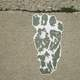 Troll Footprint on the sidewalk in Mount Horeb