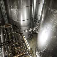 Large metal tanks and machinery at New Glarus Brewery
