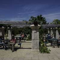 People sitting at old-fashion outdoors tables at New Glarus Brewery
