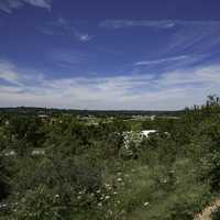 Trees, town, landscape, and sky overlook in New Glarus