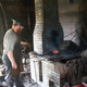 Blacksmith Heating Metal at Anvil