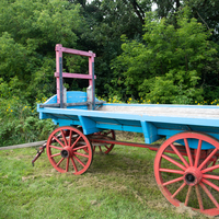 Blue farm cart with Red Wheels