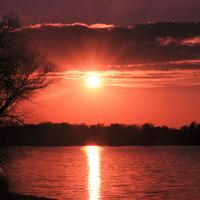 Red Sun over lake at Pike Lake State Park, Wisconsin