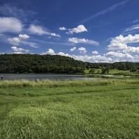 Landscape with blue sky and clouds with green grass at Indian lake