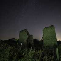 Night Stars in the Sky above Ruins House