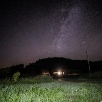 Stars behind the house and hills at Hogback Prairie