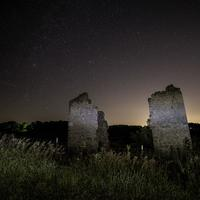 Stars over the Ruined posts of a house