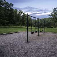 Swingset and landscape under the sky at Stewart Lake County Park