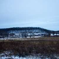 Landscape and hills under overcast sky in Wisconsin