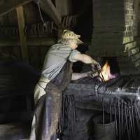Blacksmith working at the Forge