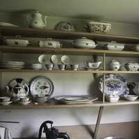 Kitchen with plates on shelves