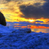 Sunrise over the ice at Whitefish Dunes State Park, Wisconsin