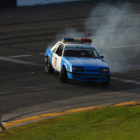 Old Police Car burning Rubber