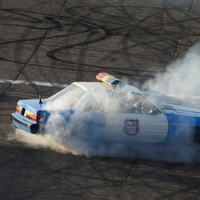 Spinning of old police car burning rubber