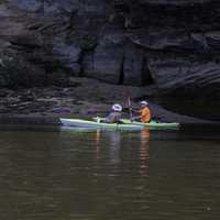 Two people rowing down the Wisconsin River