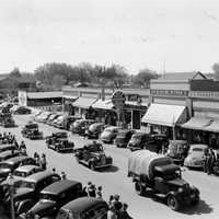 Parade of vehicles from Civilian Conservation Corps in Lovell Wyoming