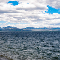 Across the waters  of Yellowstone Lake and mountains
