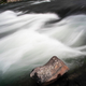Close up of smooth flowing water of rapids