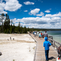 People on the walkway under the clouds by Yellowstone Lake