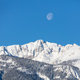 The moon above Electric peak after a winter storm