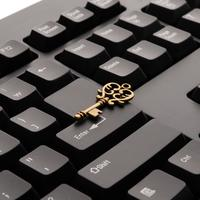 Black Keyboard with Golden Key on it