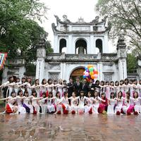 Group of people posing at the Temple of Literature in Hanoi, Vietnam