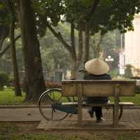 Person sitting on a bench on Hanoi, Vietnam